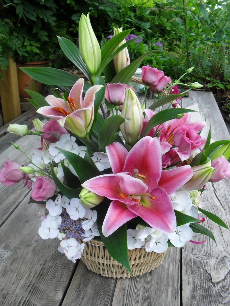A basket arrangement of lillies